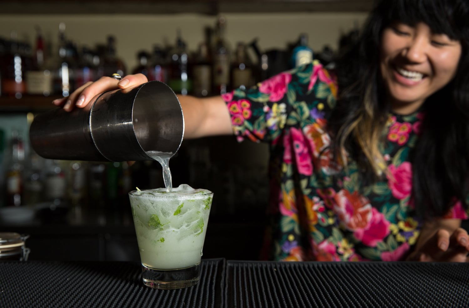 Photo of bartender pouring a cocktail at Virgil's Sea Room