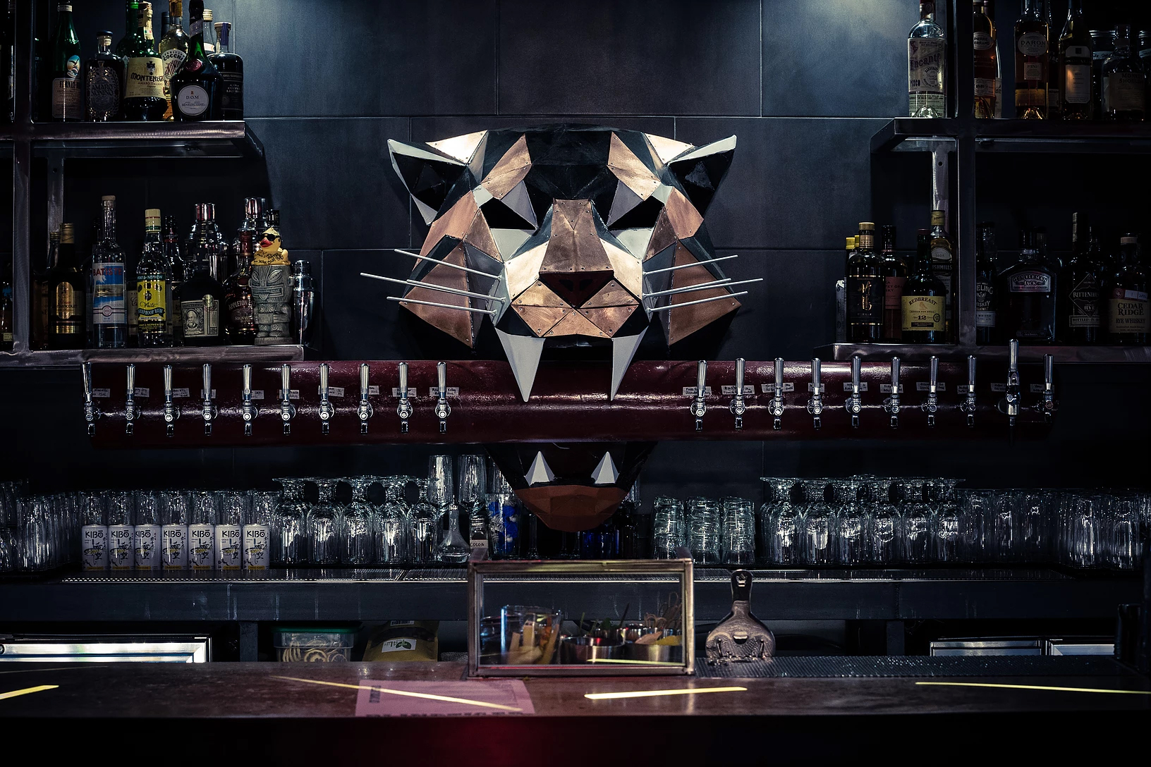 Photo of a sculpture of a metal tiger head mounted above the bar at Blind Tiger in Oakland